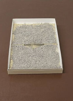 Gabriel Kuri 'Untitled Sandbox' 2008. Card box, newspaper, kitty litter. Courtesy of the artist and Esther Schipper, Berlin.